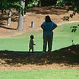 Checking out his golf course with Grandma