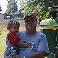 Nate and Grandpa by the tractor