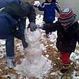 The Schneiders are a snowman building team!