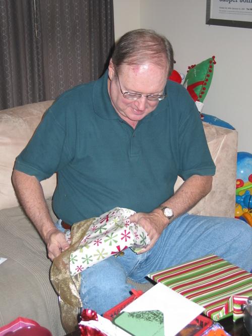 Dad opens Erin's present